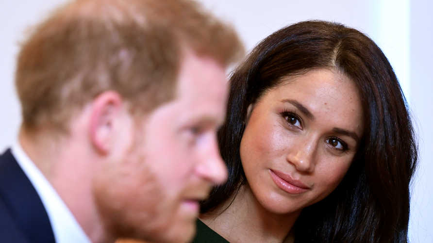 (FILES) In this file photo taken on October 15, 2019 Britain's Prince Harry, Duke of Sussex, and Britain's Meghan, Duchess of…