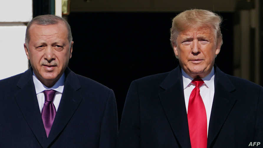 (FILES) In this file photo US President Donald Trump greets Turkey's President Recep Tayyip Erdo?an(L) upon arrival outside the…