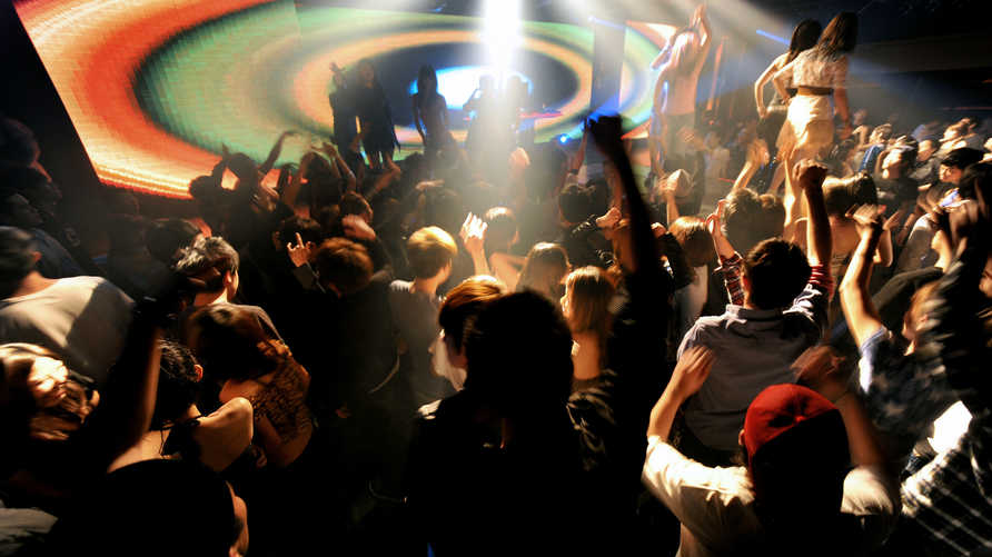 """This general view shows Taiwanese dancing at a club during a """"ladies night"""" promotion in the Chung-Li area of Taoyuan county,…"""