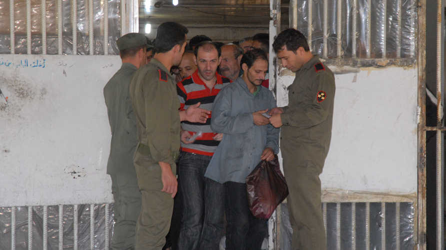 A handout picture released by the official Syrian Arab News Agency (SANA) shows some of the 274 inmates being readied for…