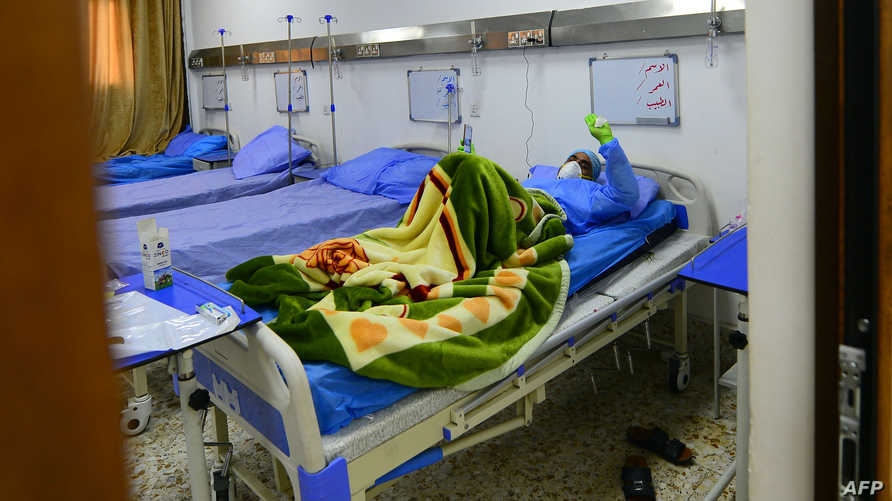 An Iraqi coronavirus patient rests at a special ward at the Hakim Hospital in Najaf on March 25, 2020 amid the coronavirus…