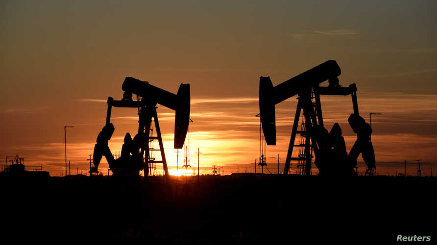 FILE PHOTO: Pump jacks operate at sunset in an oil field in Midland, Texas U.S. August 22, 2018. Picture taken August 22, 2018…