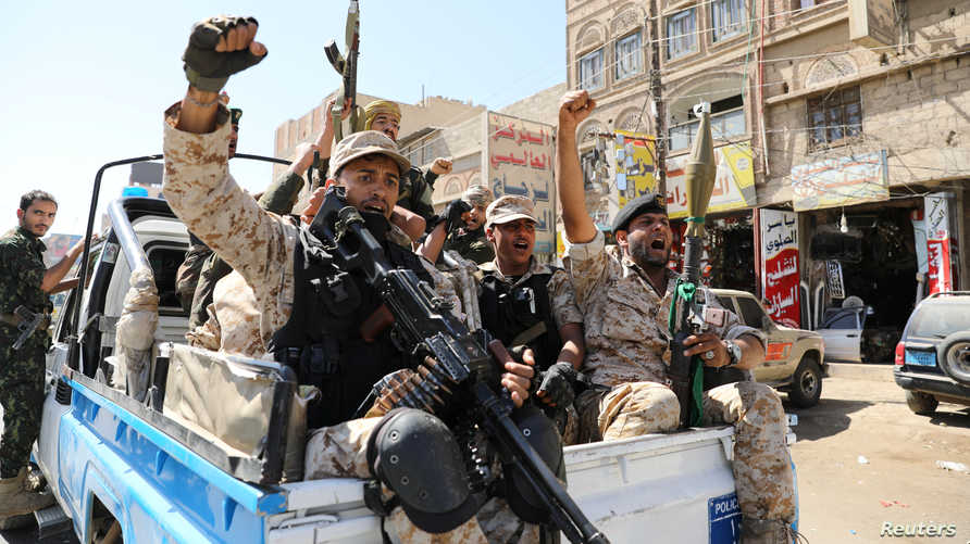 Houthi troops ride on the back of a police patrol truck after participating in a Houthi gathering in Sanaa, Yemen February 19,…