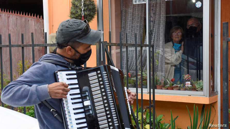 Gonzalo Acuna plays his accordion to lift his parents' spirits after they starting practicing social isolation in their house…