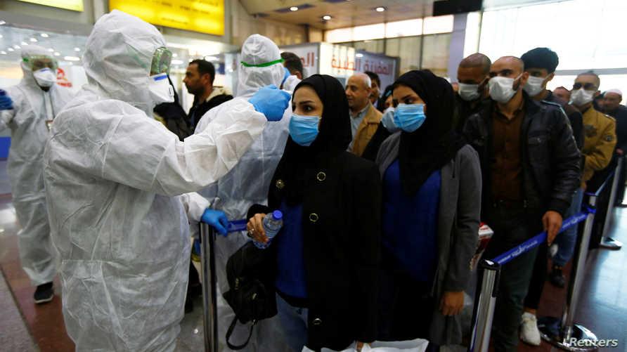 فحص المسافرين في مطار بغداد