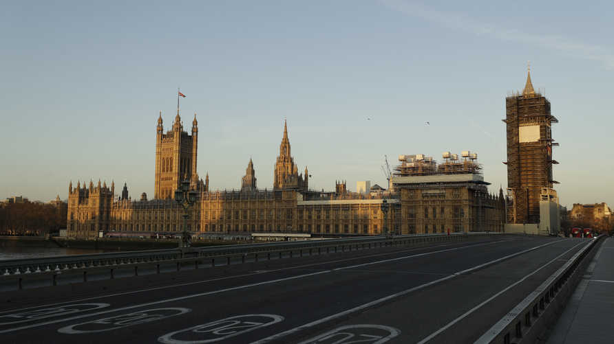 An almost empty Westminster Bridge normally a very busy river crossing as the sun rises in London, Tuesday, March 24, 2020…
