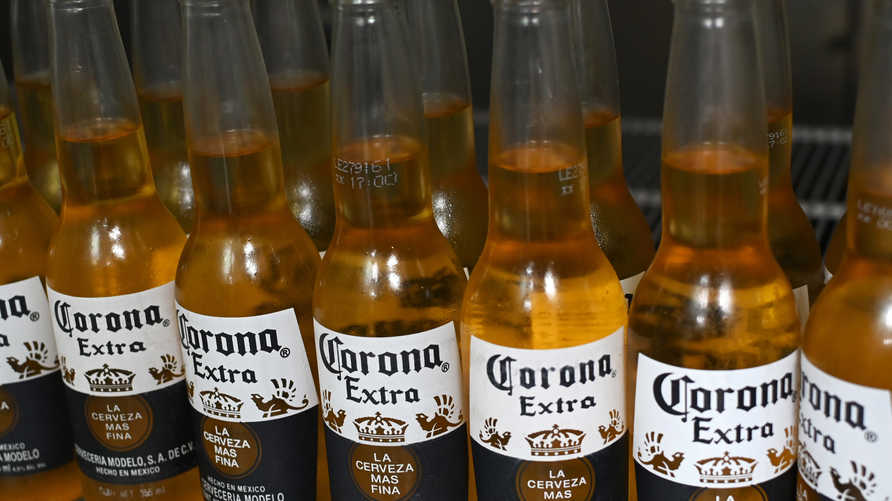 Picture of bottles of Mexican beer Corona, taken in Mexico City on June 4, 2019. - Donald Trump faced fierce opposition Tuesday…