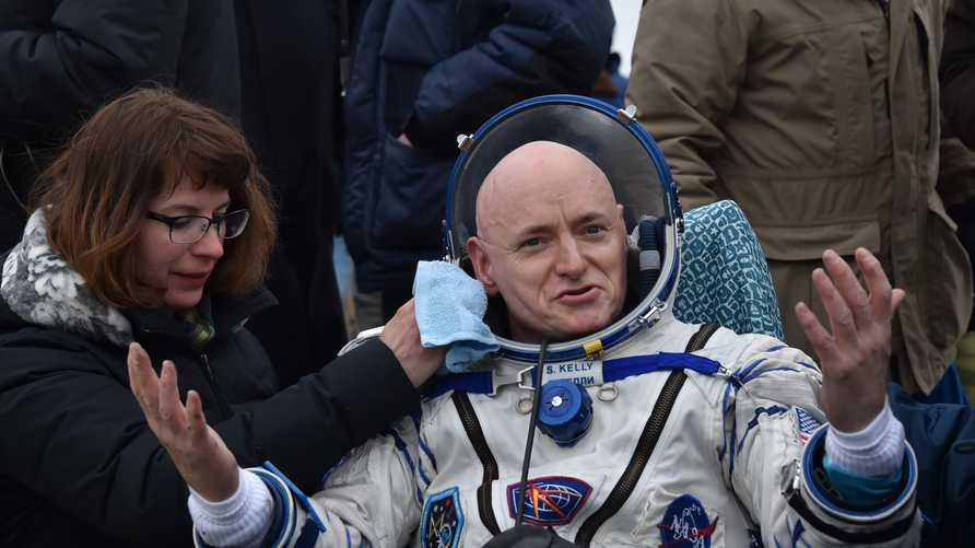 (FILES) In this file photo taken on March 2, 2016 International Space Station (ISS) crew member Scott Kelly of the U.S. reacts…