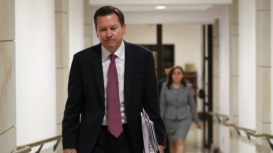 (FILES) In this file photo Michael Atkinson, Inspector General of the Intelligence Community, leaves a meeting in the U.S…