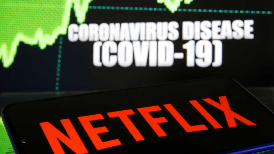 FILE PHOTO: Netflix logo is seen in front of diplayed coronavirus disease (COVID-19) in this illustration taken March 19, 2020…