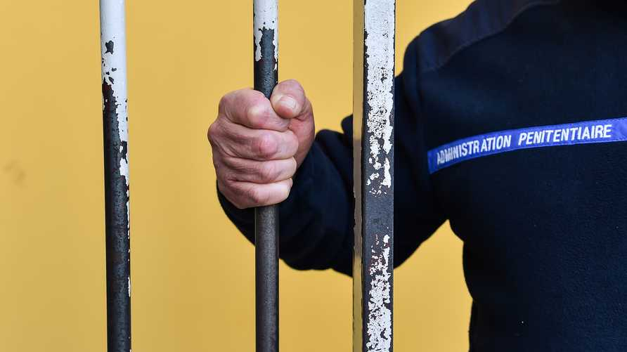 A prison warder holds the bars of a door at the entrance of the MAF (Maison d'arret pour femmes - Women detention house) at the…