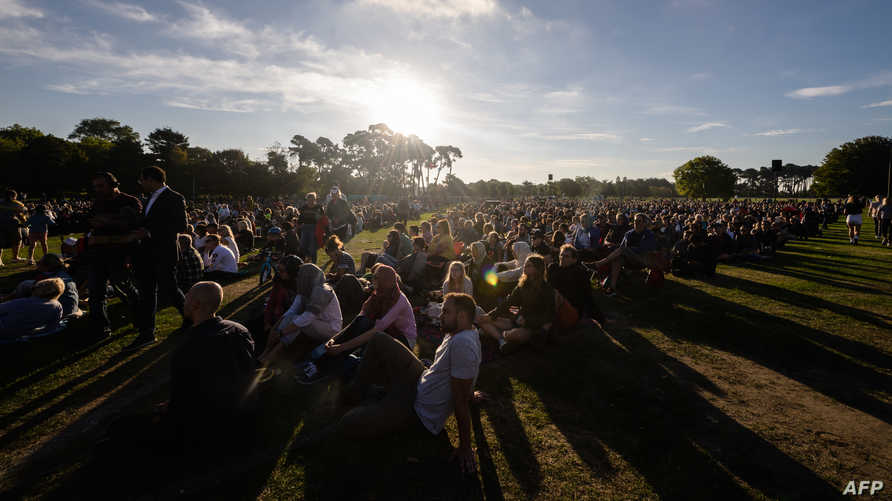People attend a vigil in memory of the twin mosque massacre victims in Christchurch on March 24, 2019. - New Zealand will hold…