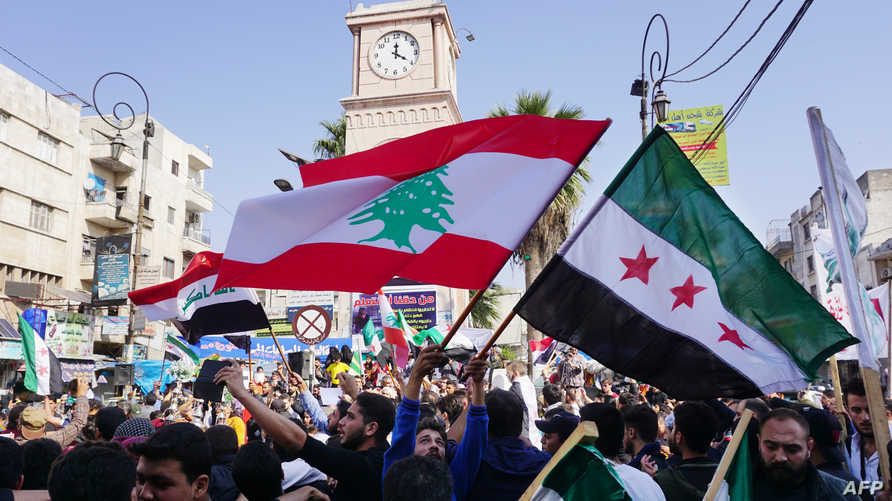 Syrians demonstrate on October 25, 2019 in the rebel-held city of Idlib in northwestern Syria in support of Lebanon's massive…