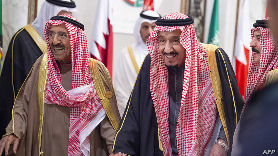 A handout picture provided by the Saudi Royal Palace shows  Saudi King Salman bin Abdulaziz (R) and Kuwaiti Emir Sheikh Sabah…