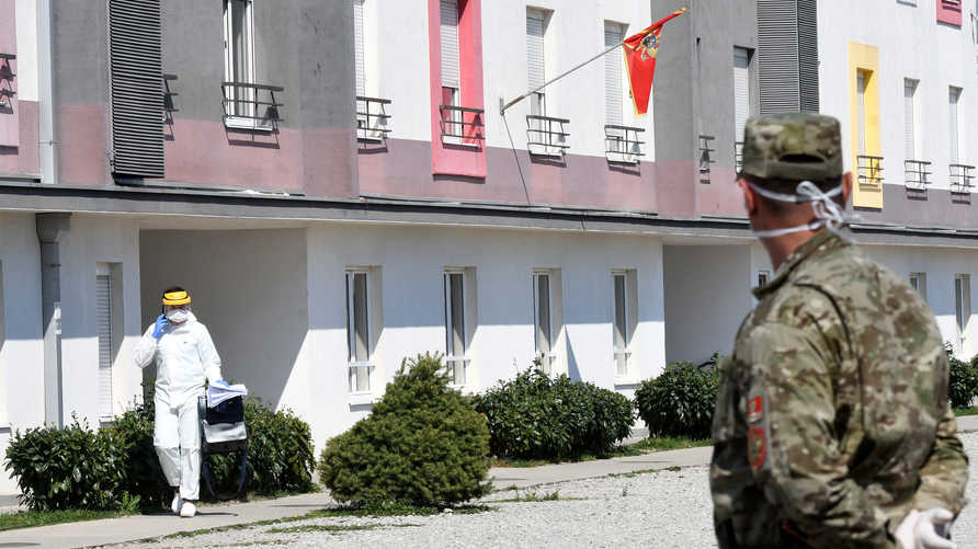 Montenegrin army personnel guard the entrance to a building dedicated to be a quarantine for travellers from abroad at the…