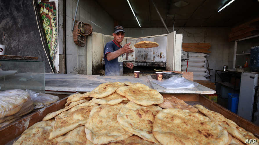 A baker prepares flat bread ahead of the Muslim holy month of Ramadan, during the novel coronavirus pandemic crisis in the…