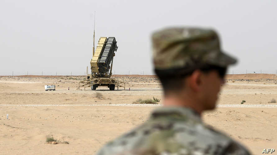 (FILES) In this file photo taken on February 20, 2020 a member of the US Airforce looks on near a Patriot missile battery at…
