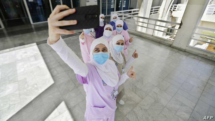 Lebanese nurses take a selfie as they celebrate International Nurses Day at the Rafik Hariri public hospital in Lebanon's…