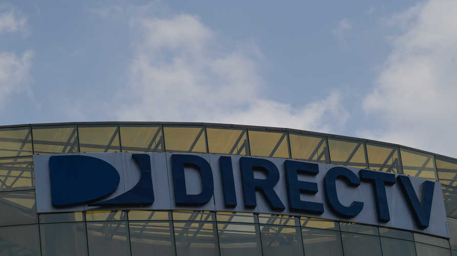 View of DirecTV broadcast satellite service provider logo at its headquarters in Caracas on May 19, 2020. - US…