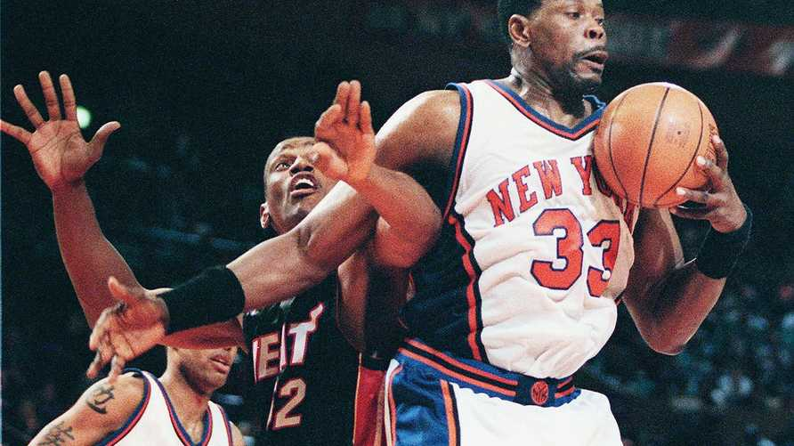New York Knicks center Patrick Ewing (R) and Miami Heat forward Otis Thorpe (L) battle for a rebound in the first quarter 06…