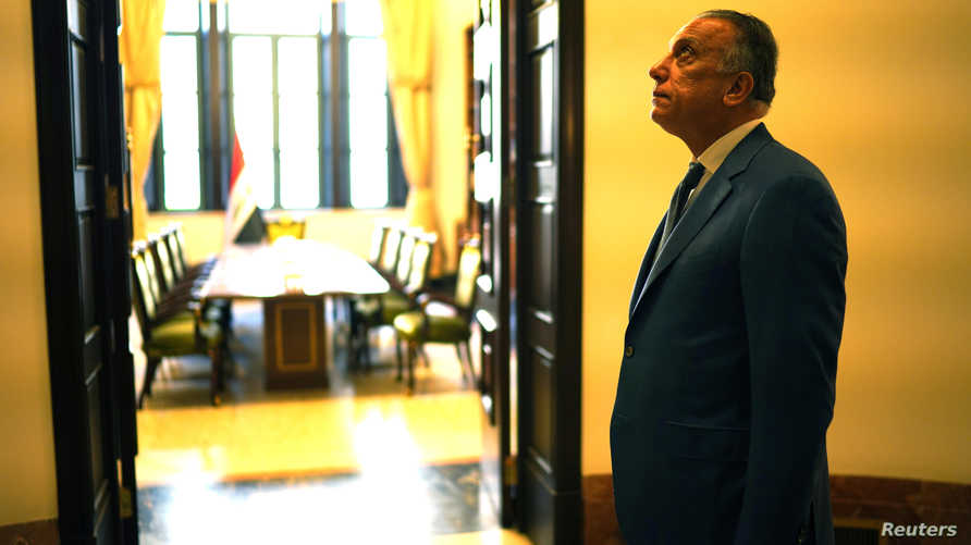 Iraqi Prime Minister Mustafa al-Kadhimi waits for delegations at the prime minister's office in Baghdad, Iraq May 14, 2020…