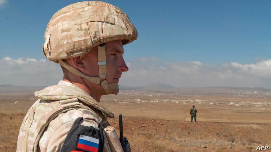 A member of the Russian military police patrols near the village of Tal Krum in the Syrian Golan Heights on August 14, 2018. …