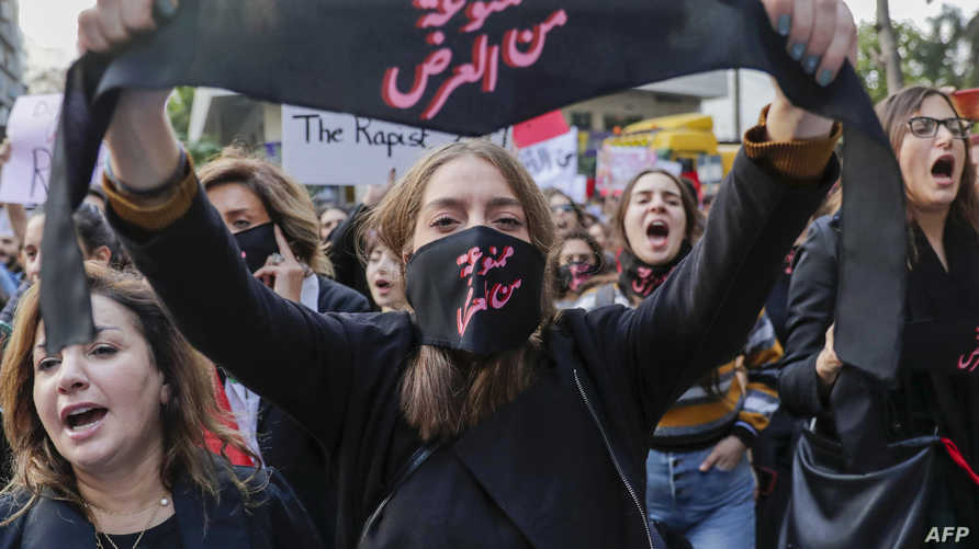 An activist takes part in a demonstration against sexual harassment, rape and domestic violence in the Lebanese capital Beirut…