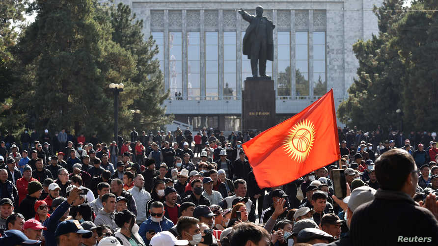 People attend a rally to demand the resignation of Kyrgyzstan's President Sooronbai Jeenbekov in Bishkek, Kyrgyzstan October 14…