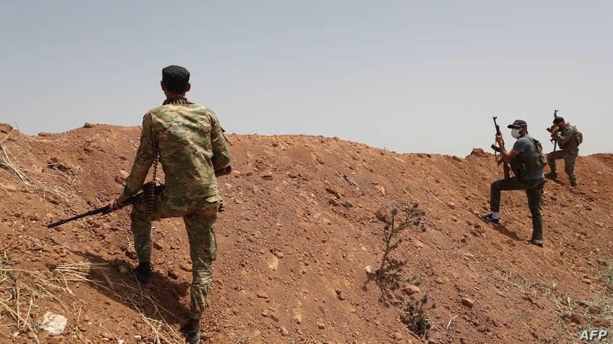تقرير دولي يقدر عدد قوات داعش والقاعدة في العراق وسوريا بنحو20 ألف مقاتل
