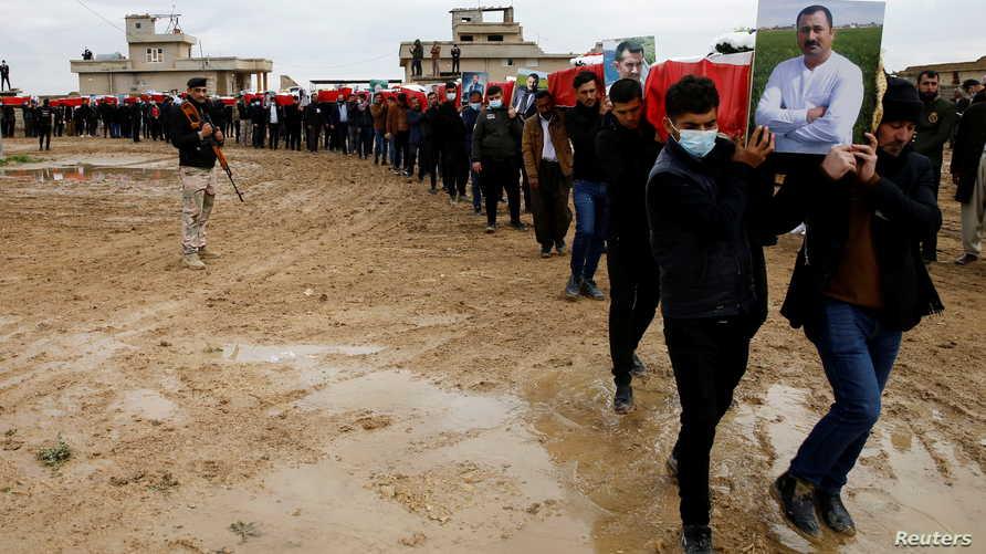 إعادة دفن رفات ما تبقى من 104 إيزيدي قضوا على يد تنظيم داعش قبل ست سنوات - 6 فبراير 2021