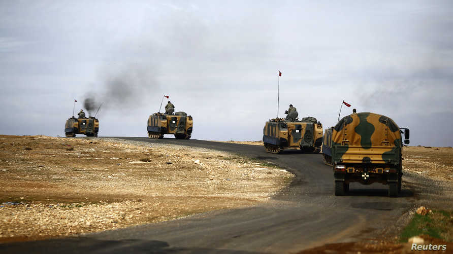 Turkish army vehicles move to position near the  Mursitpinar border crossing, on the Turkish-Syrian border in the southeastern…