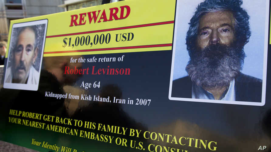 An FBI poster showing a composite image of  former FBI agent Robert Levinson, right, of how he would look like now after five…