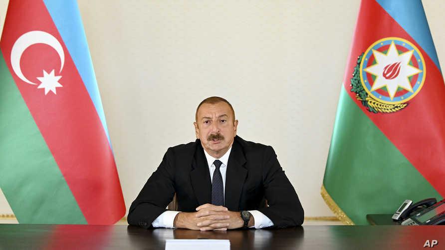 In this photo provided by the Azerbaijan's Presidential Press Office provided on Sunday, Sept. 27, 2020, Azerbaijani President…