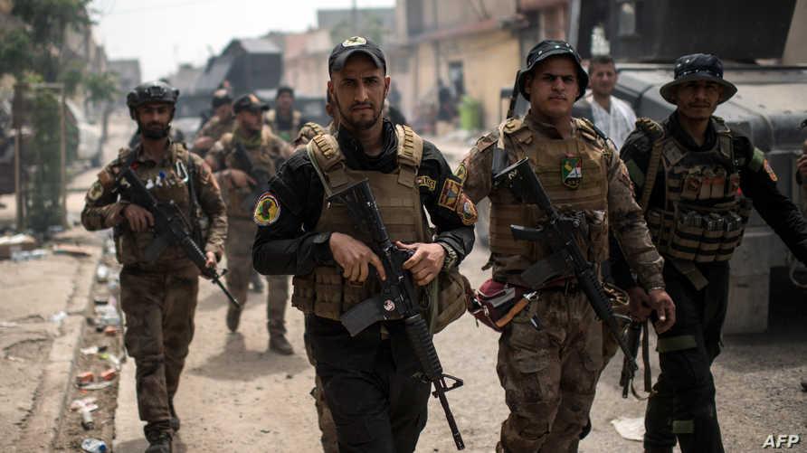 عناصر من قوات جهاز مكافحة الإرهاب والرد السريع غرب الموصل خلال معركة تحرير المدينة من قبضة داعش