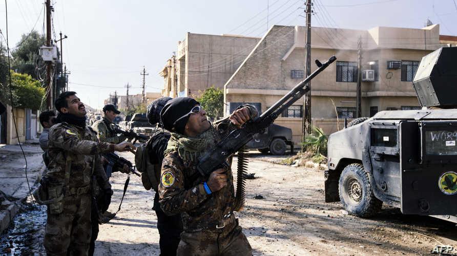 عناصر في قوات مكافحة الإرهاب خلال مواجهات في الموصل- أرشيف