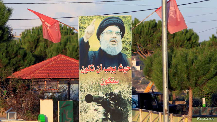 A poster depicting Lebanon's Hezbollah leader Sayyed Hassan Nasrallah is seen in Naqoura
