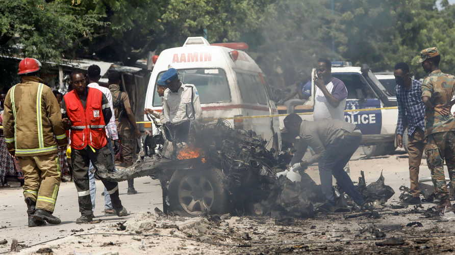 Rescuers, security and paramedics are seen at the scene of a car explosion near Banadir hospital in Mogadishu