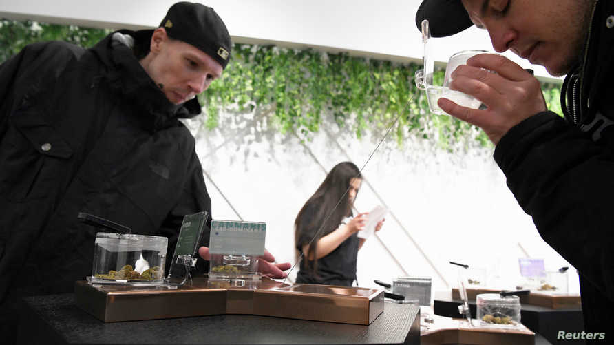 Customers at the Hunny Pot Cannabis Co. retail cannabis store shop as marijuana retail sales commenced in the province of…