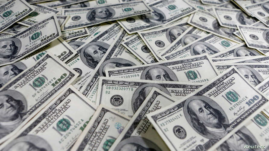 FILE PHOTO: One hundred dollar notes are seen in this photo illustration at a bank in Seoul, South Korea, January 9, 2013…