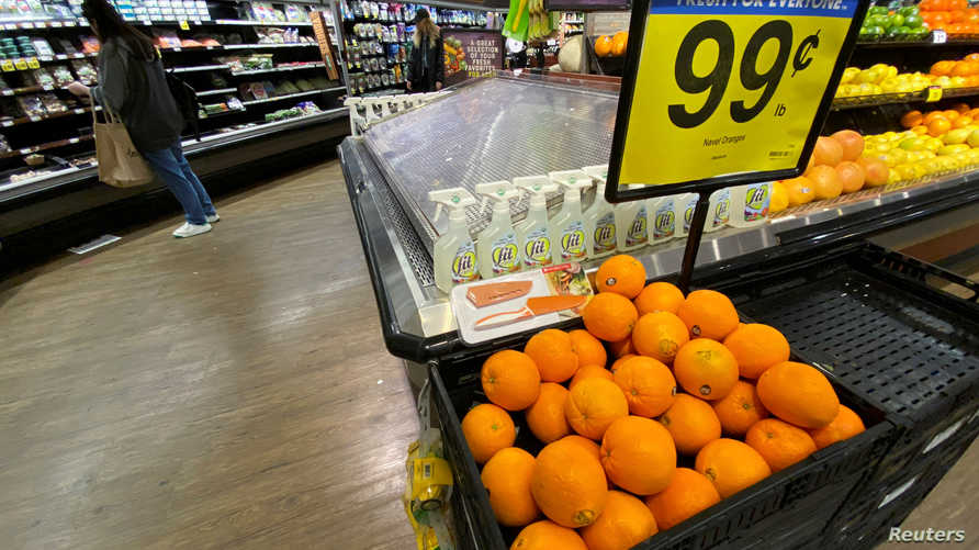 Oranges are displayed for sale at the produce area as a customer browses grocery store shelves inside Kroger Co.'s Ralphs…