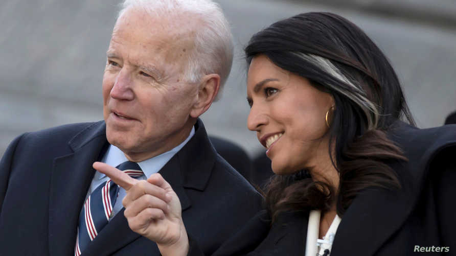 FILE PHOTO: Democratic U.S. presidential candidate and former U.S. Vice President Joe Biden speaks with fellow Democratic U.S…