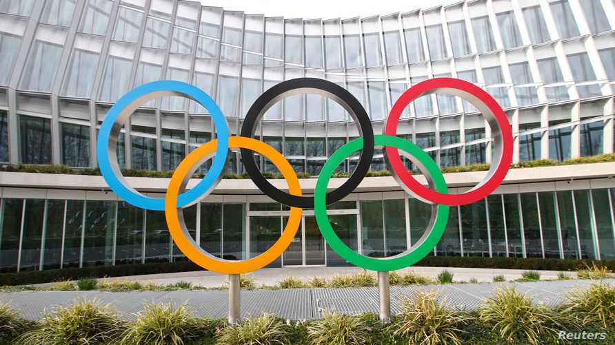 FILE PHOTO: The Olympic rings are pictured in front of the International Olympic Committee (IOC) in Lausanne, Switzerland,…
