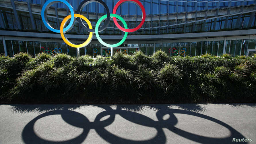 The Olympic rings are pictured in front of the International Olympic Committee (IOC) headquarters, during the coronavirus…