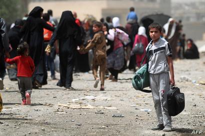 عراقيون فروا من داعش غربي الموصل