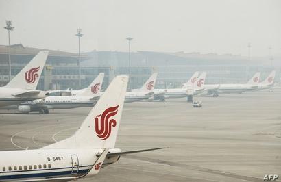 طائرة الخطوط الجوية الصينية في مطار بكين الدولي