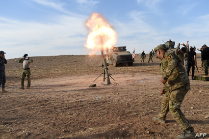 القوات العراقية تقصف مواقع لداعش من مركزها في القيارة