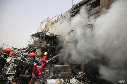 رجال إطفاء موقع التفجير في بغداد الجديدة