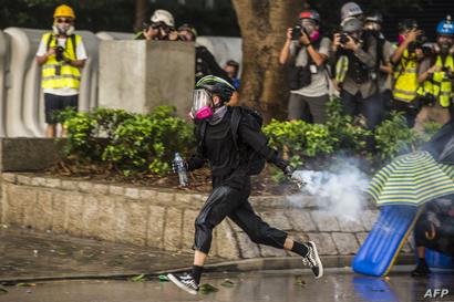 صدامات بين الشرطة والمتظاهرين الأحد في هونغ كونغ