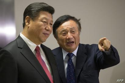 مؤسس هواوي رين زنغفاي والرئيس الصيني شي جين بينغ. أرشيفية