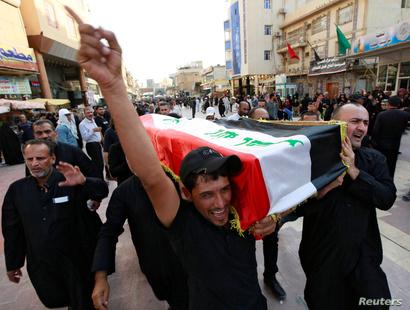 تشييع أحد قتلى التظاهرات في النجف